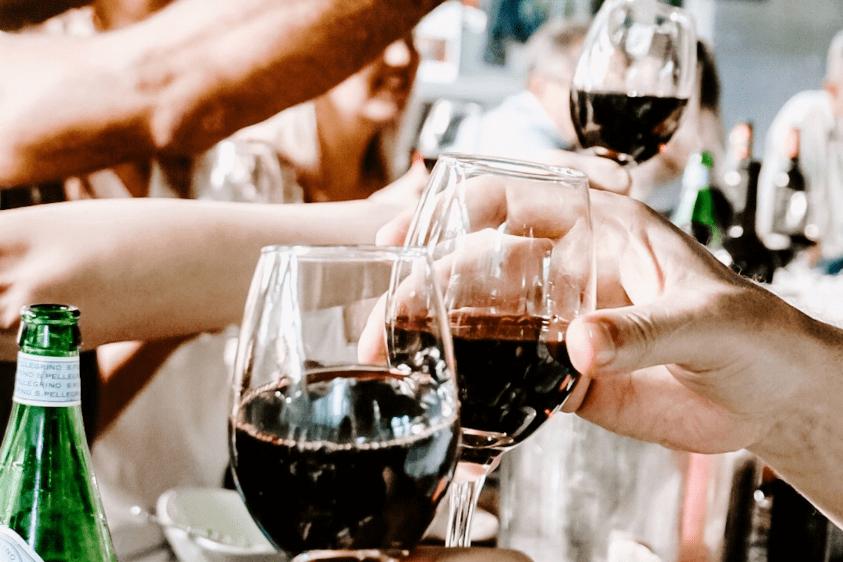 people toasting red wine