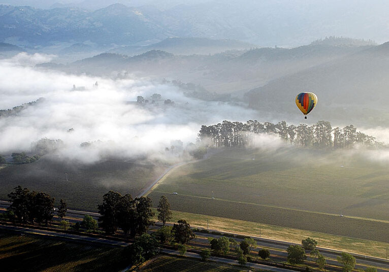 Hot air balloon in a valley